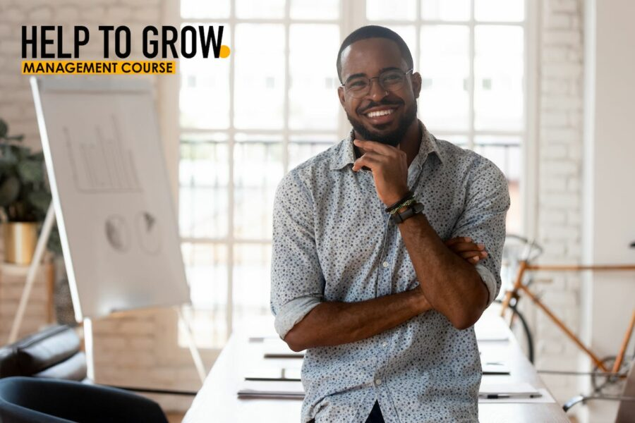 Photo of smiling man with Help to grow logo and smiling man